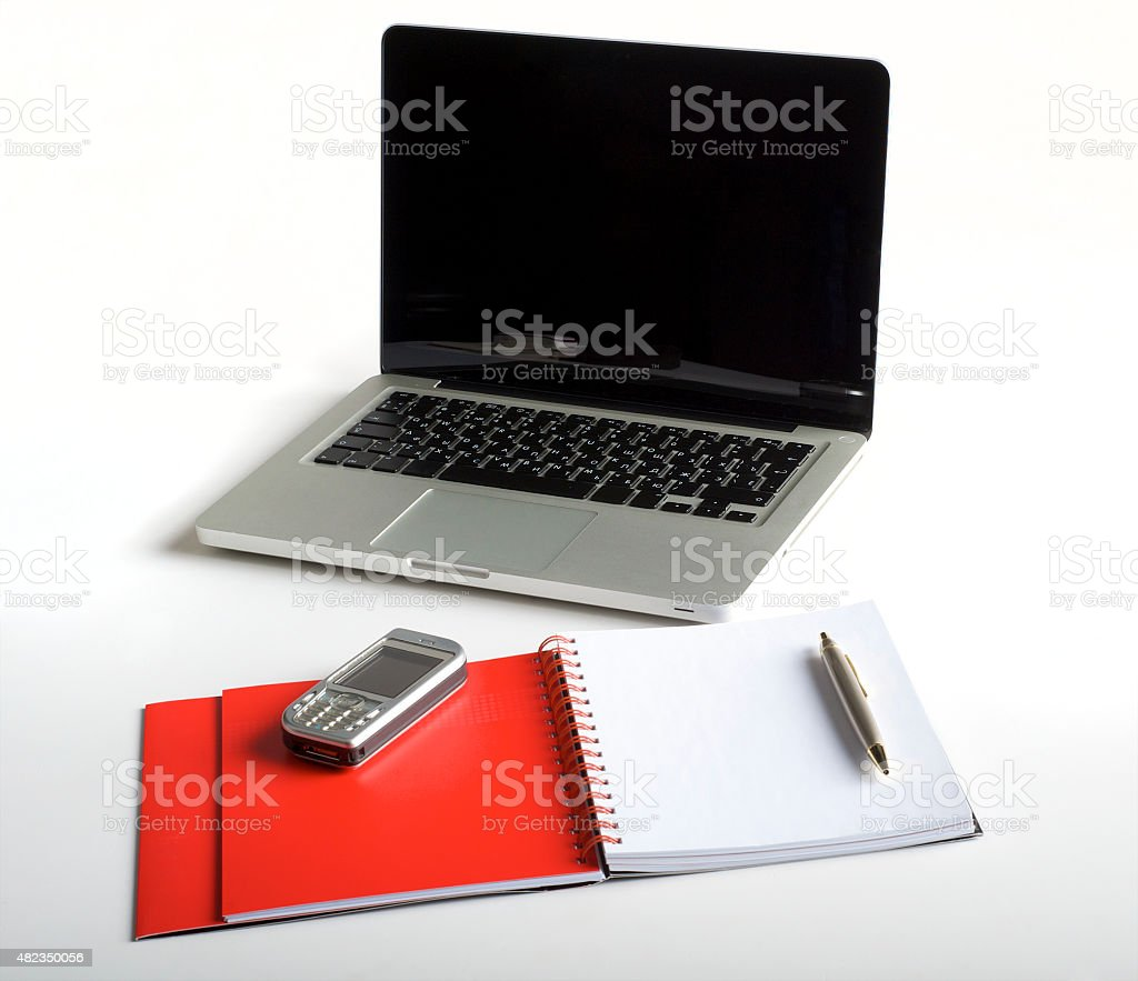 Phone, laptop and empty notebook stock photo