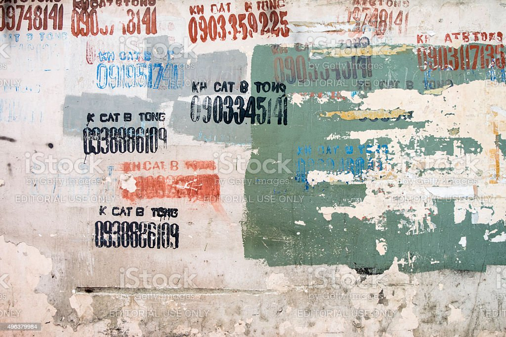 Phone number and advertisement on a ruined wall stock photo