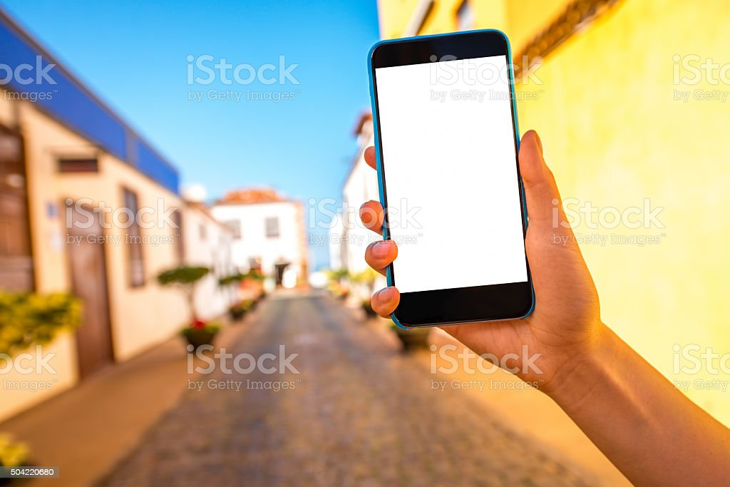 Phone on the colorful town background stock photo