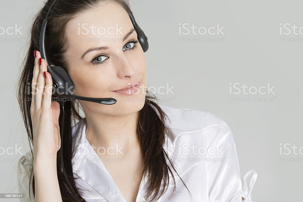 Phone operator with headset on gray background royalty-free stock photo