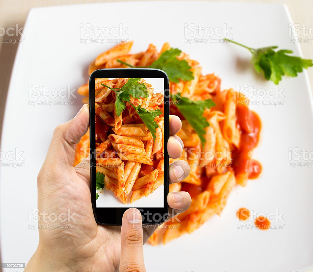phone photographing with macaroni stock photo