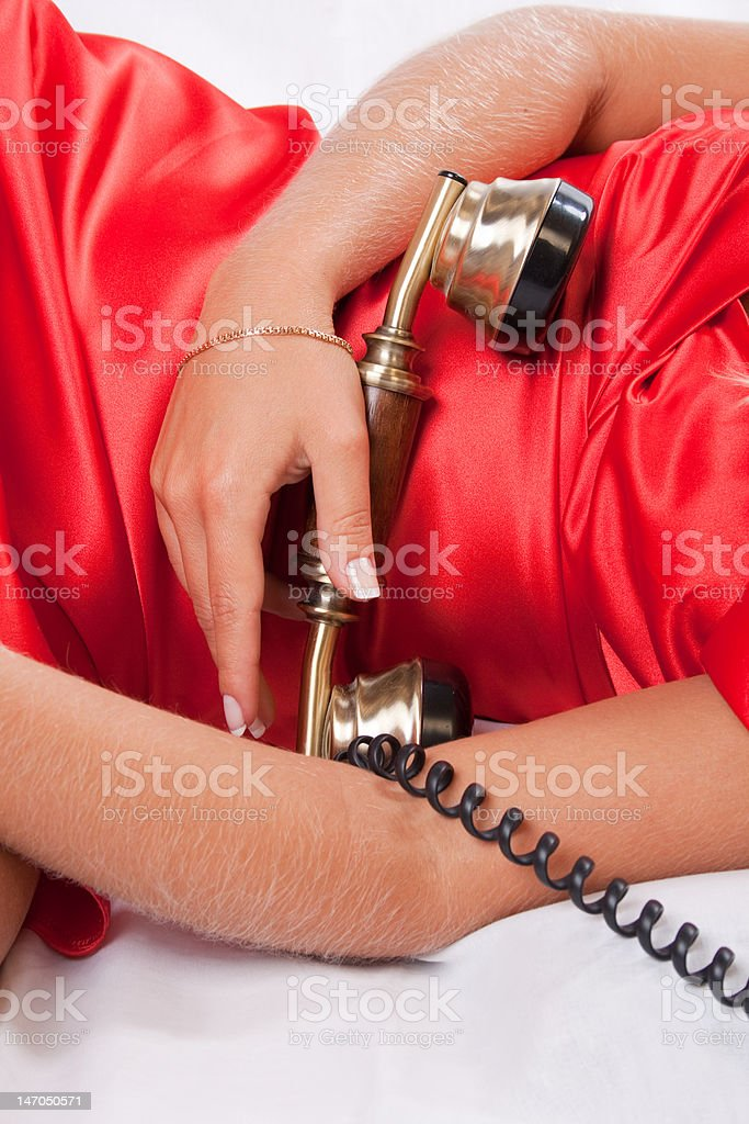 Phone receiver and woman in red stock photo