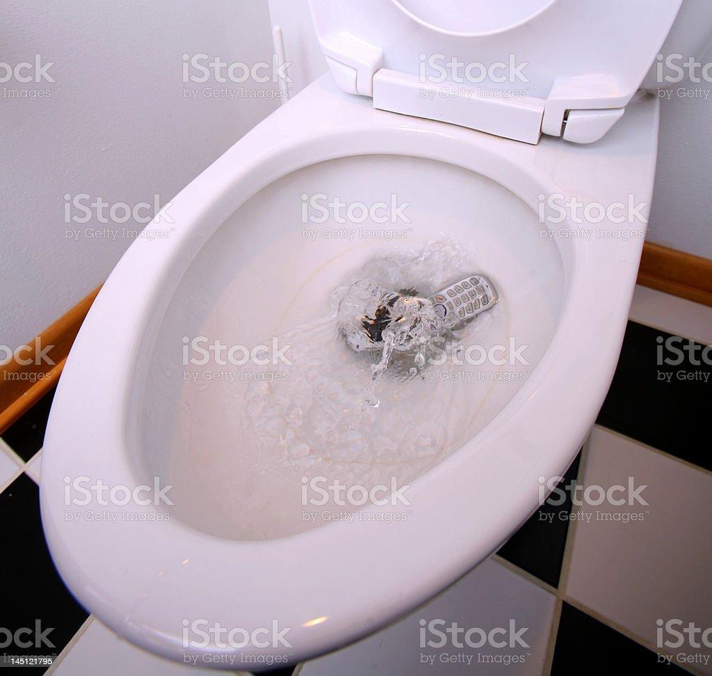 Phone Splashing into Toilet royalty-free stock photo