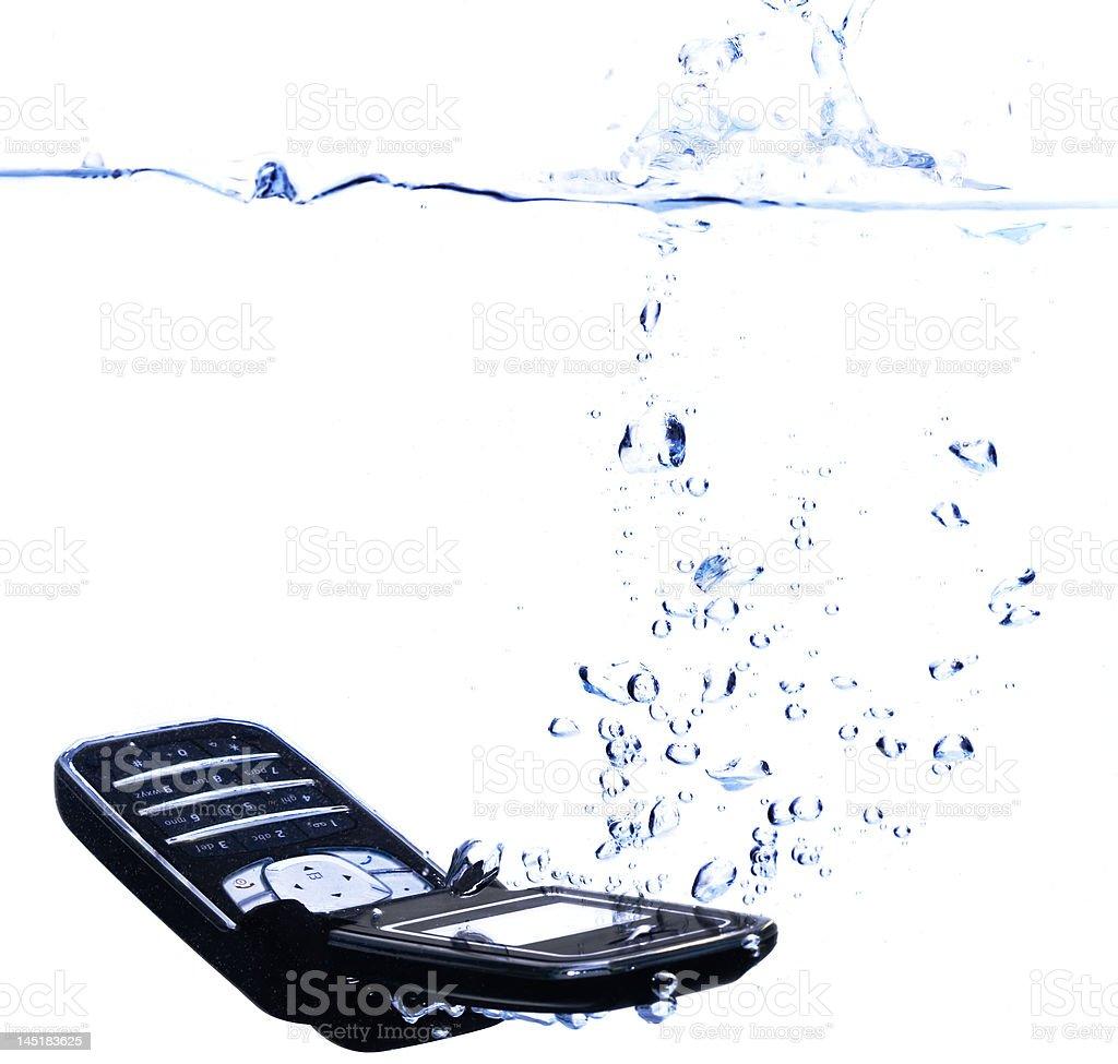 Phone splashing into water - high key royalty-free stock photo