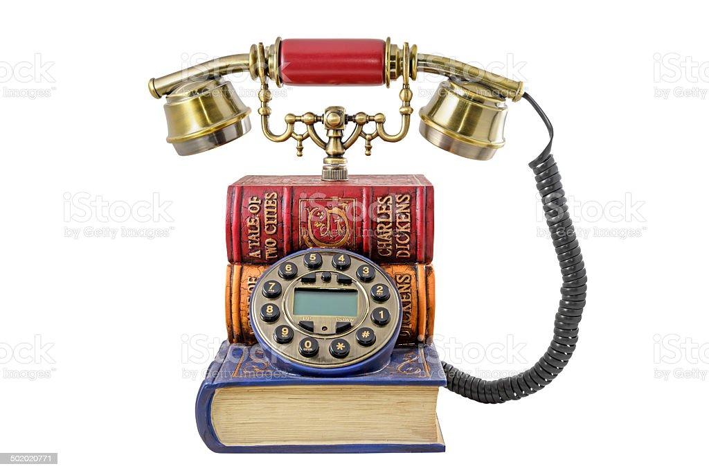 Phone stylized under a pile of books stock photo