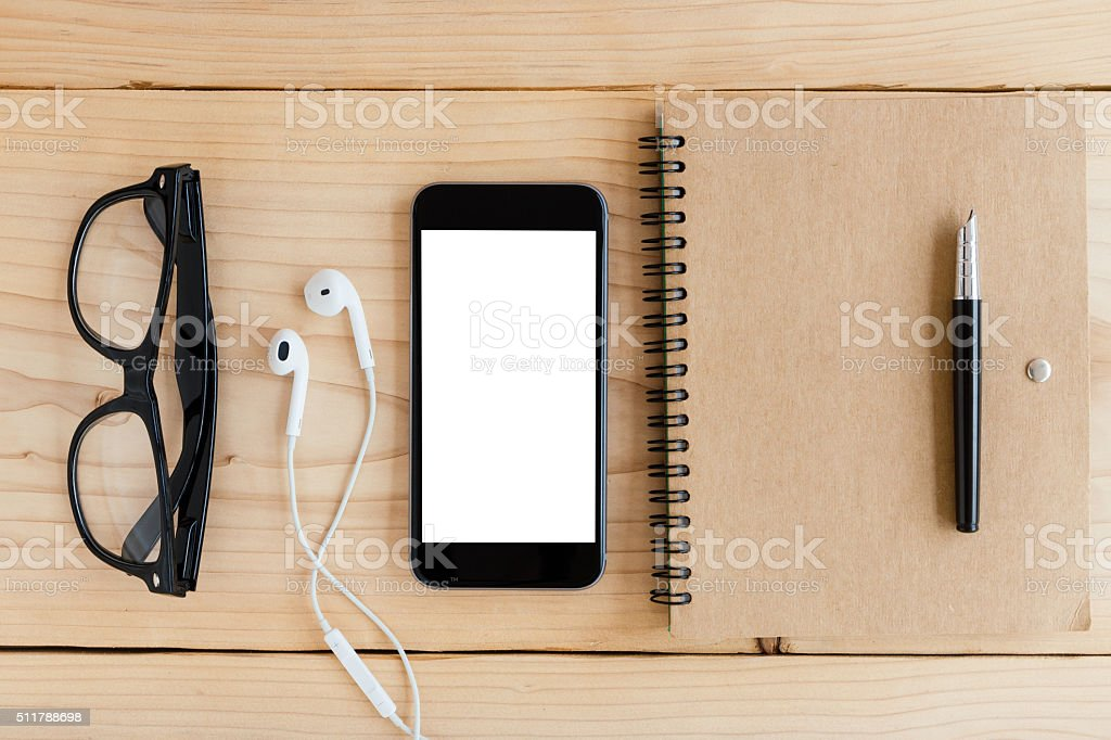 phone white screen on wood workspace top angle view stock photo