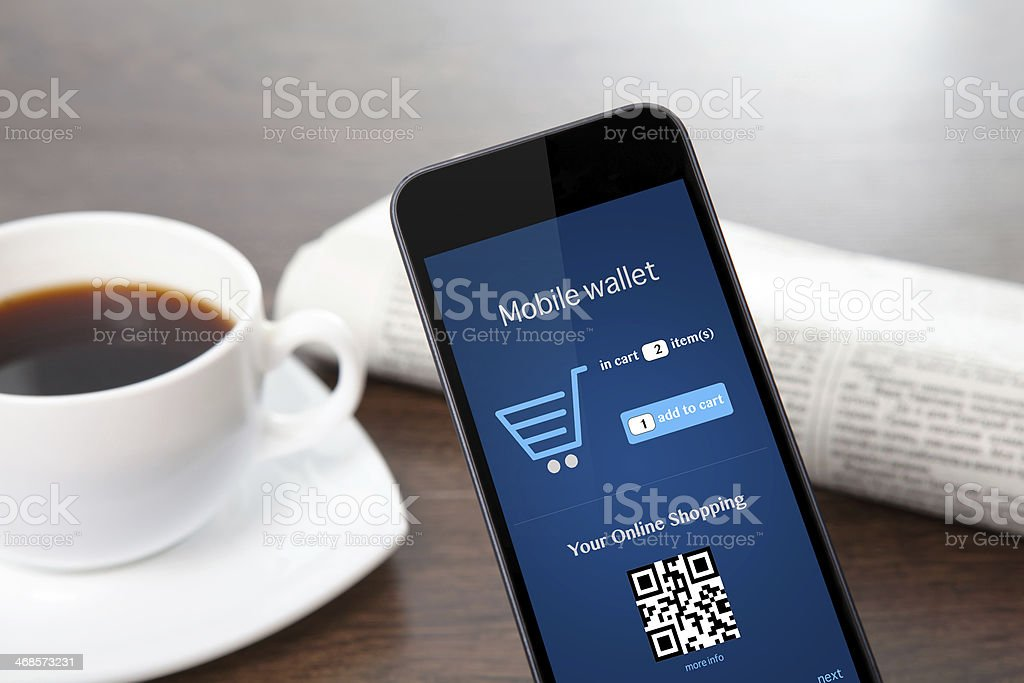 phone with online shopping the screen on a table stock photo