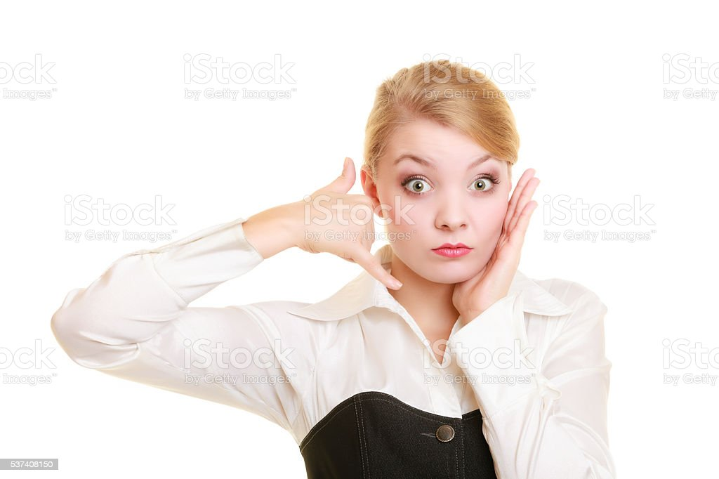 Phone. Worried businesswoman making call me gesture stock photo