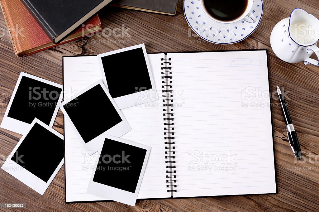 Photo album with coffee and books royalty-free stock photo