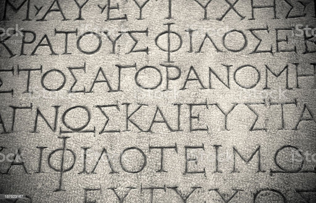 Photo ancient background letters carved in stone stock photo