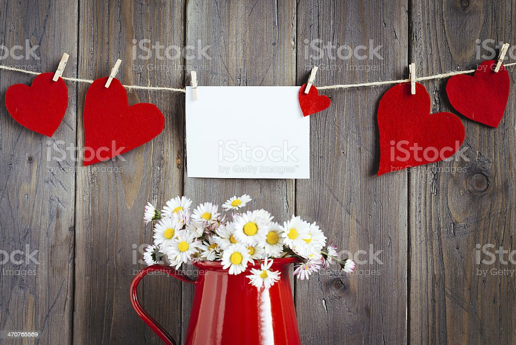 Photo and hearts on wooden wall stock photo
