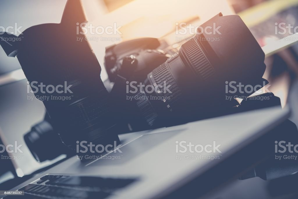 Photo Business Equipment. Modern Computer, Digital Camera and Professional Prime Lenses. Doing Photography For a Living Concept.. stock photo