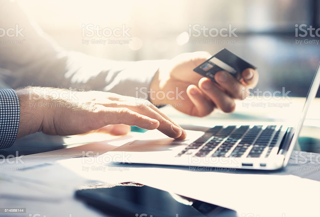 Photo businessman working with generic design notebook. Online payments, banking stock photo