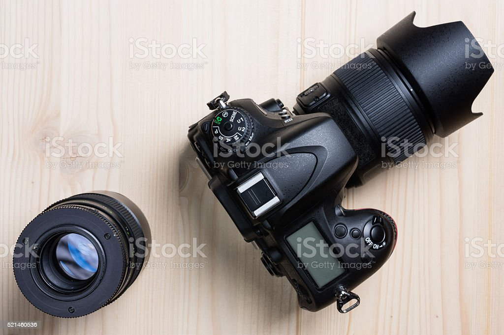 Photo camera and a lens top view stock photo