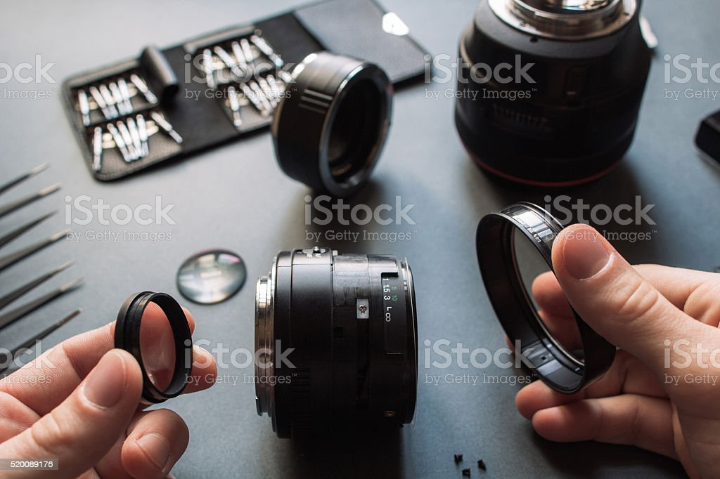 Photo camera lens repair set. Technician engineer stock photo