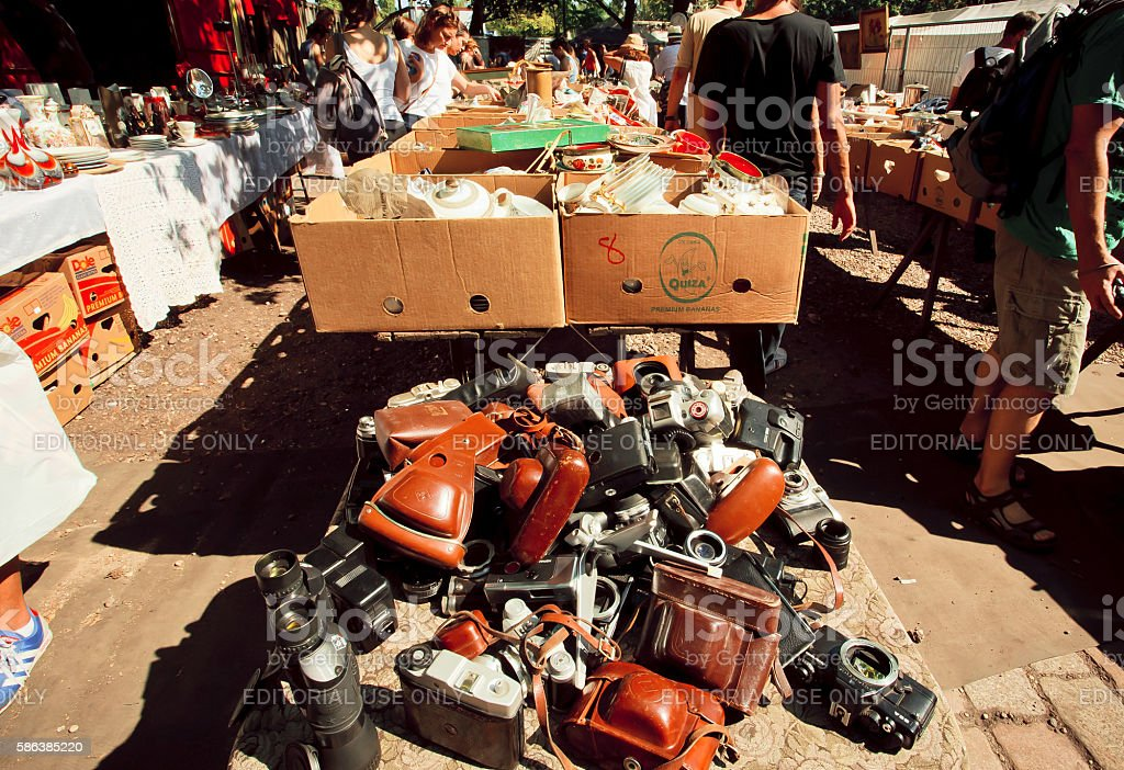 Photo cameras on layout of vendor on flea market stock photo