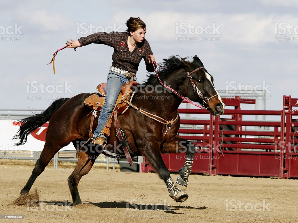 Photo Cow Girl Running Her Horse/Barrel Competition stock photo