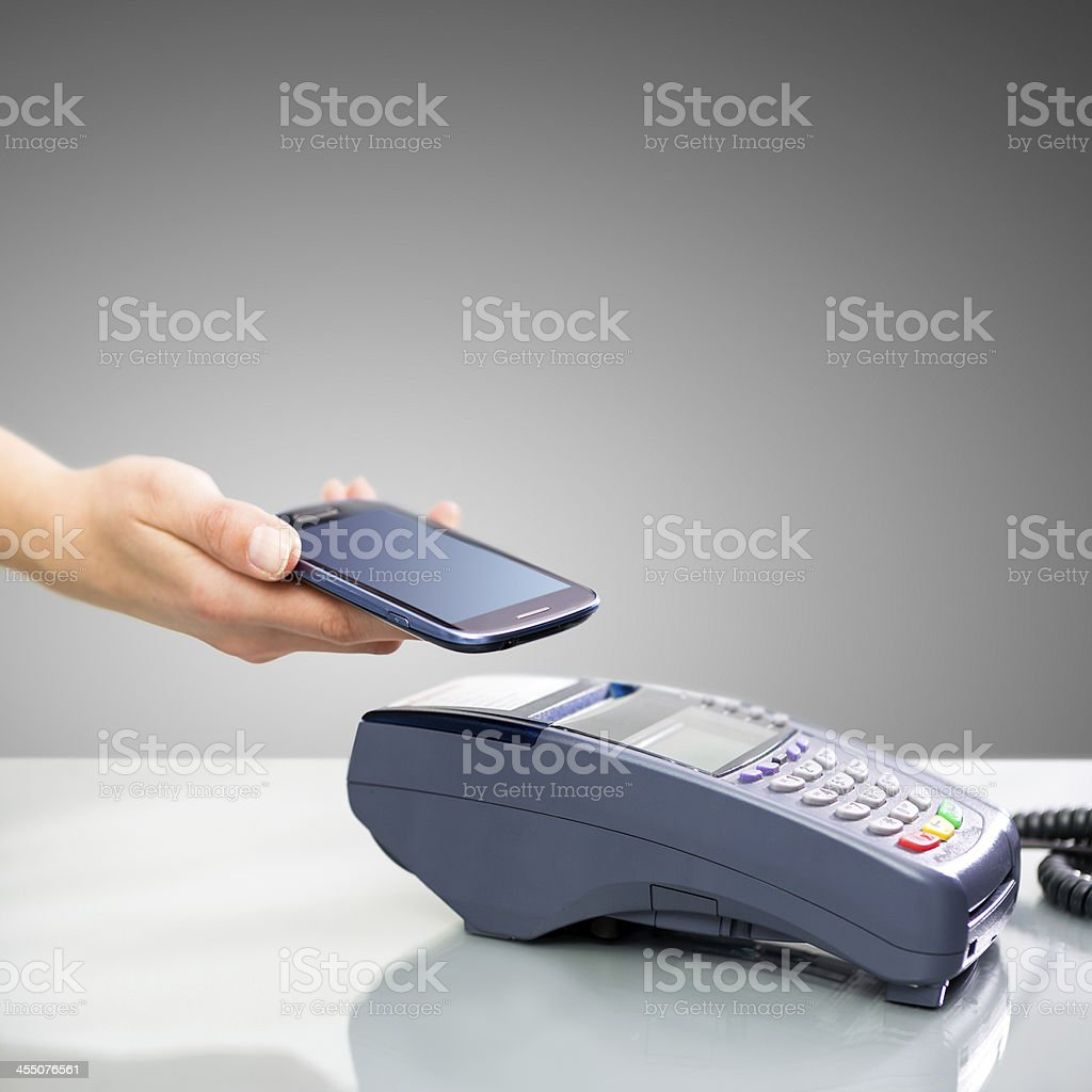Photo depicting the use of near field communication stock photo