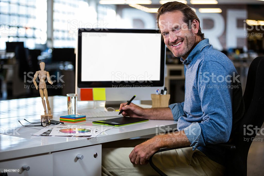 Photo editor with graphics tablet in office stock photo