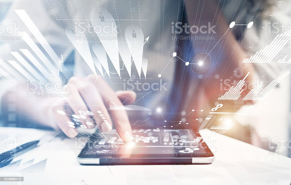 Photo female hand touching modern tablet.Investment manager working new stock photo