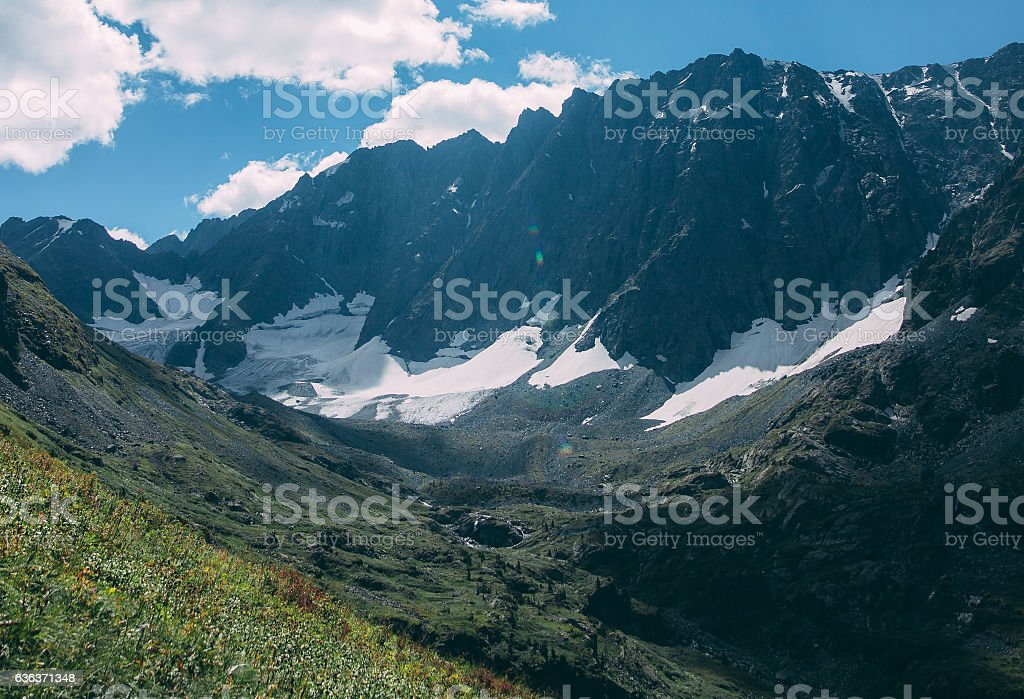 Photo film colors dark mountains on a sunny day shining stock photo