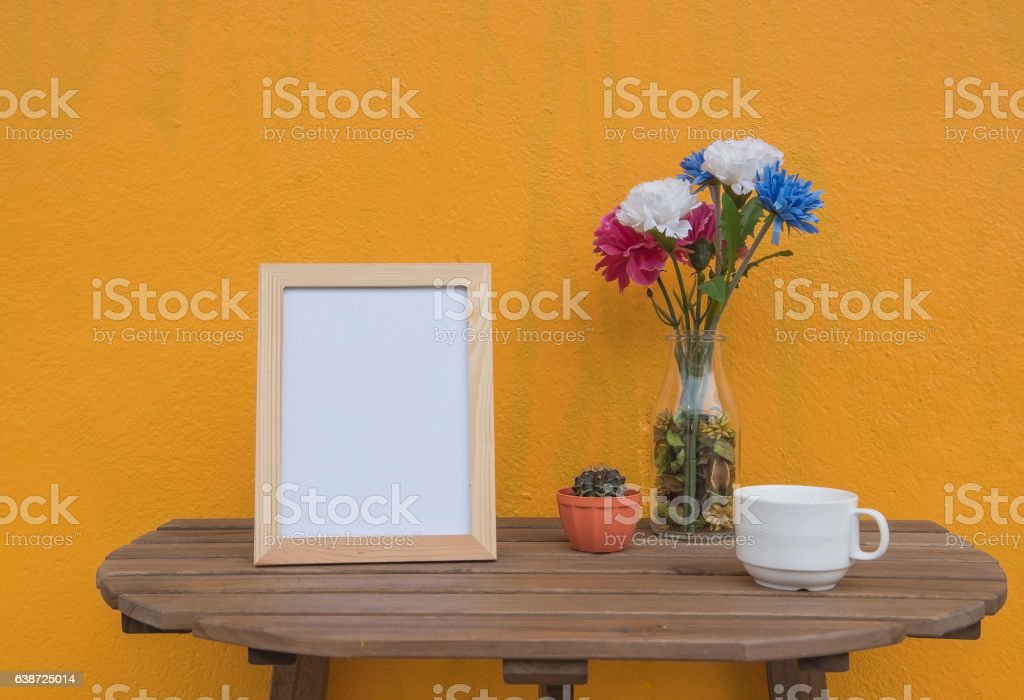 photo Frame and cup and Flowers in jar stock photo