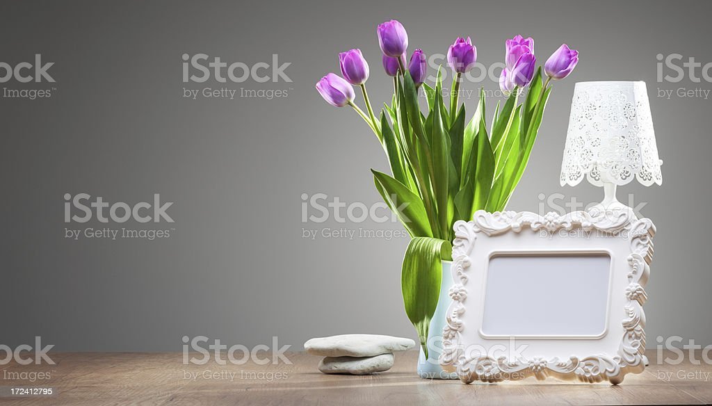 Photo frame and flowers on the desk royalty-free stock photo