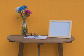 photo Frame on a wooden table and Yellow background