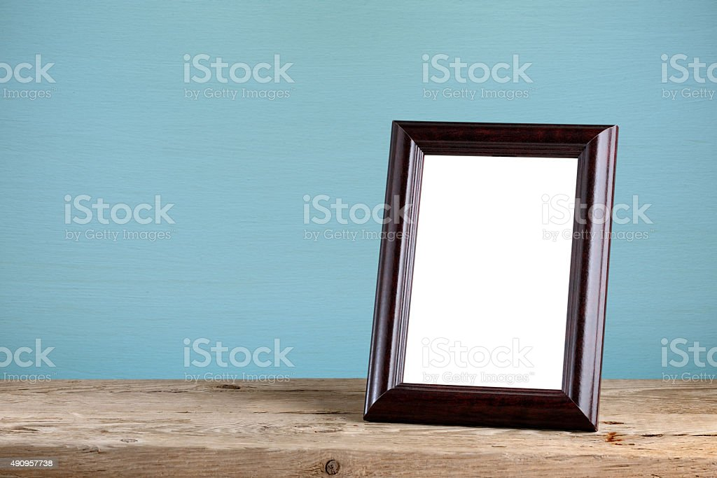 Photo frame on old wooden table stock photo