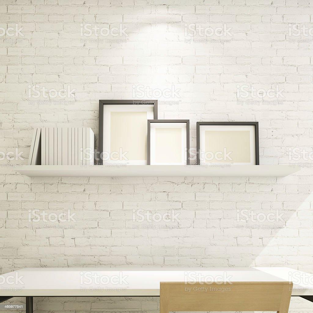 photo frame on shelf against a white brick wall stock photo