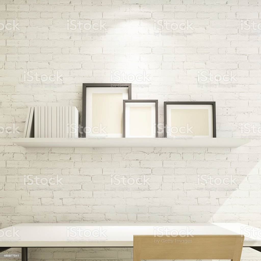 photo frame on shelf against a white brick wall stock photo