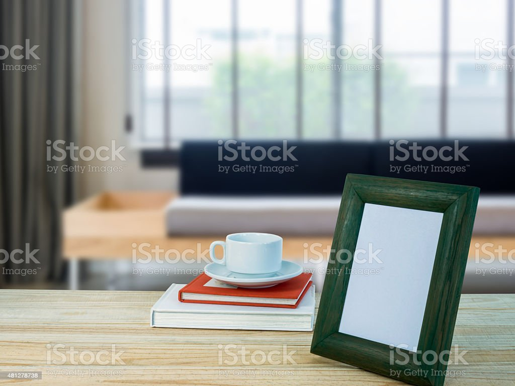 Empty wood table and blurred living room background stock photo -  Photo Frame On Wooden Table Top Living Room Blurry Background Stock Photo