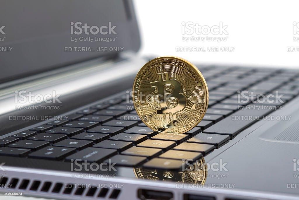 Photo Golden Bitcoin on Laptop stock photo