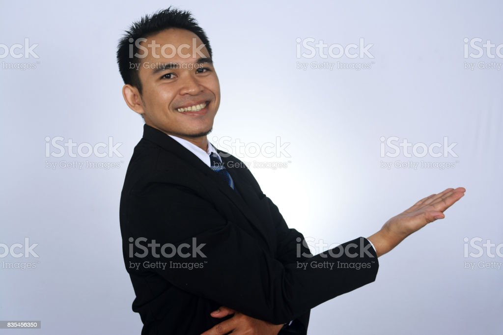 photo image of asian businessman smile with showing gesture stock photo
