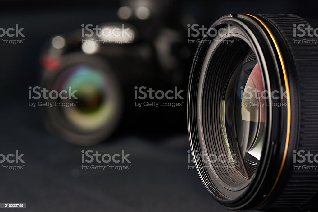 Photo lens on blurred camera stock photo