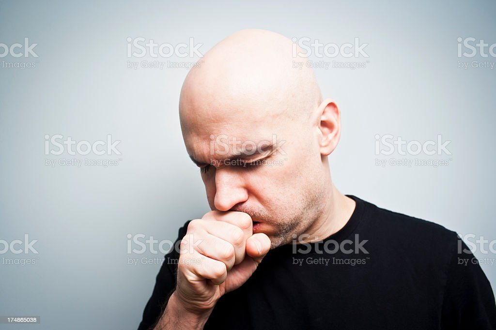 A photo of a bald man coughing on a white background stock photo
