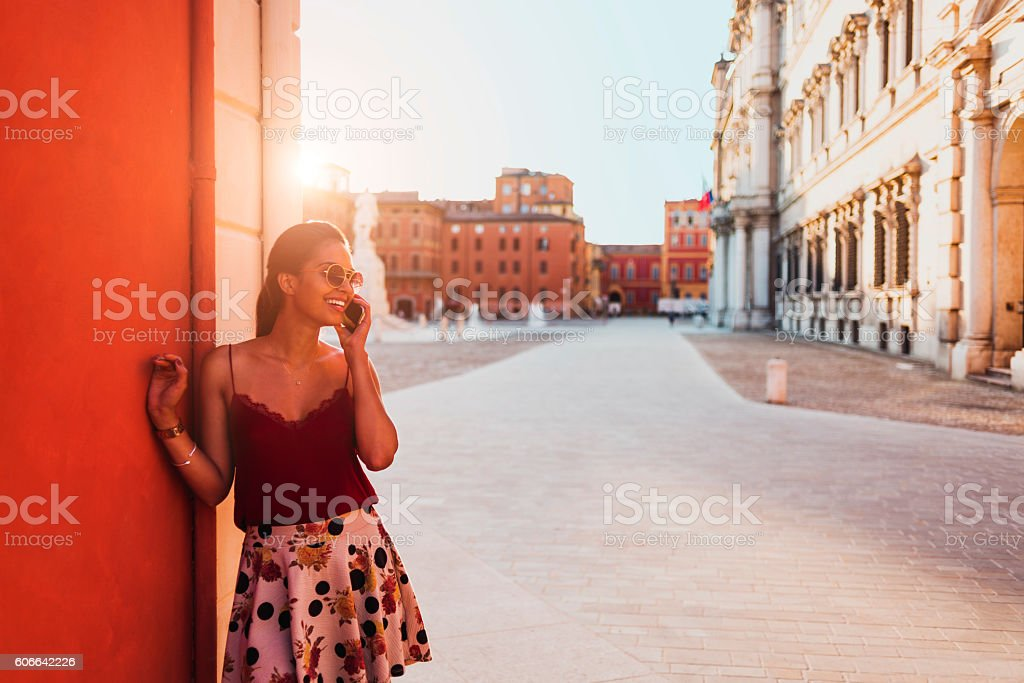 photo of a beautiful young woman talking on her smartphone stock photo