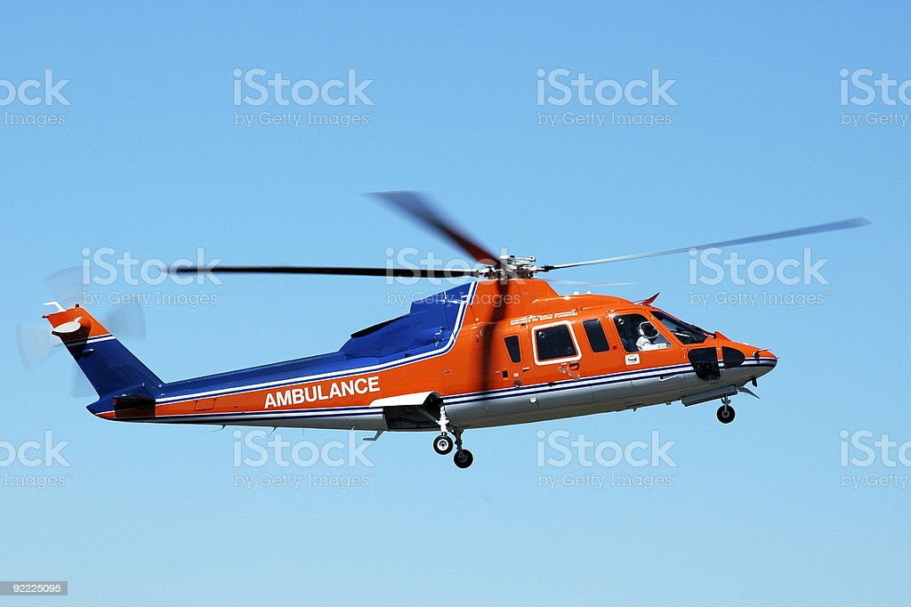 Photo of a blue and orange air ambulance helicopter stock photo