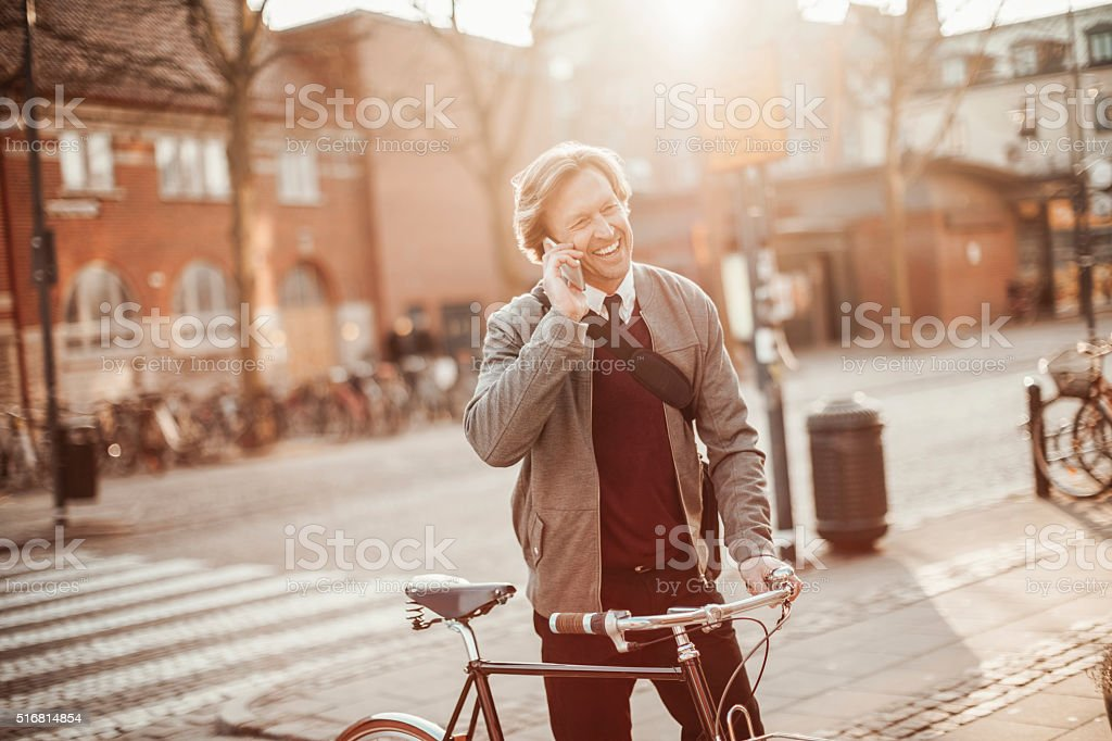 Photo of a businessman talking on mobile phone stock photo
