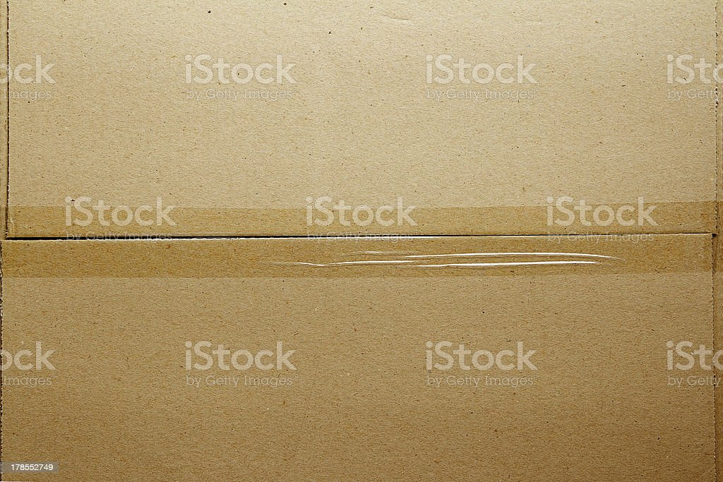 Photo of a cardboard box taped at the middle stock photo