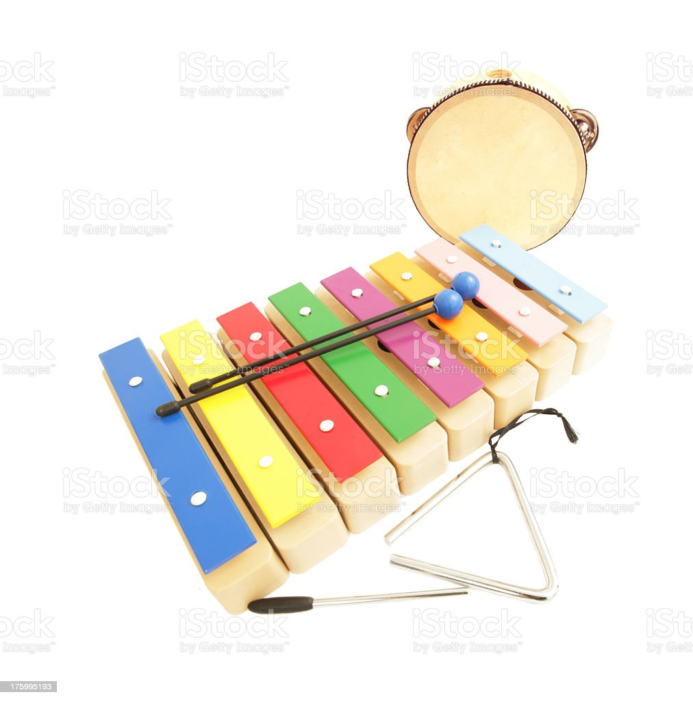Photo of a child's xylophone, triangle and tambourine royalty-free stock photo
