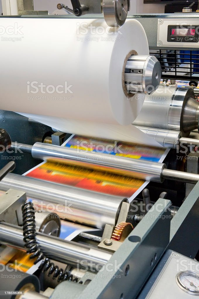 Photo of a clean and running printing machine stock photo