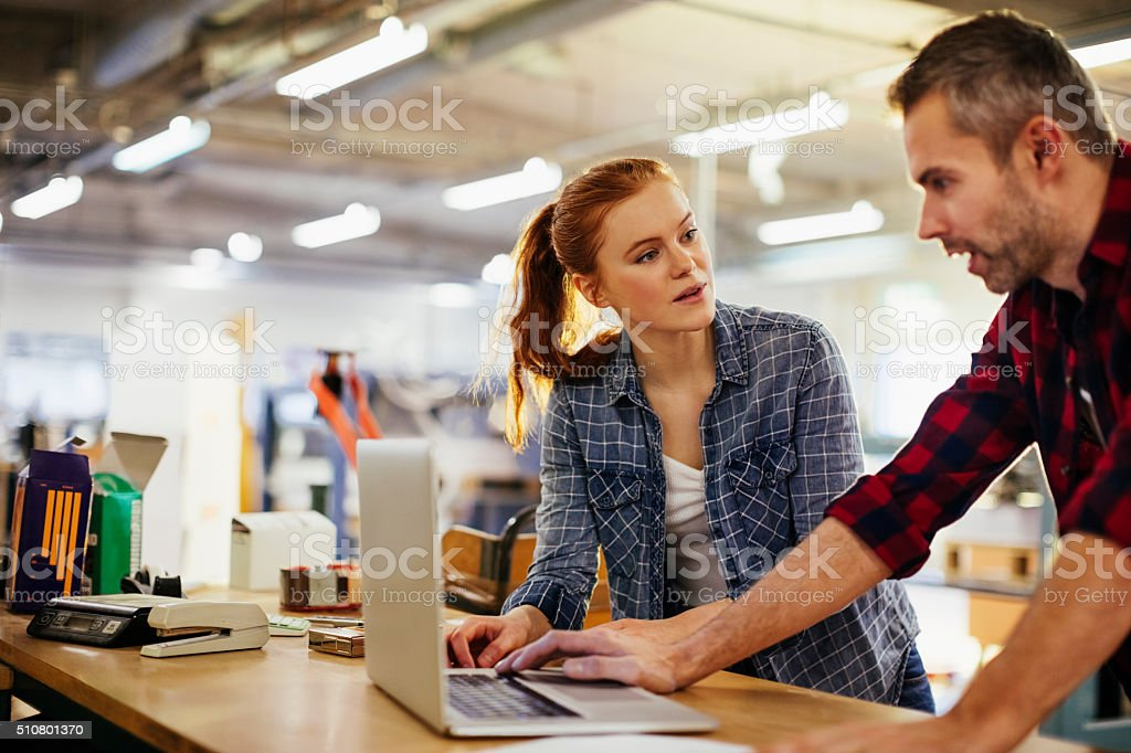 Photo of a coworkers in printing factory stock photo