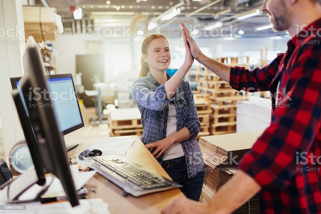 Photo of a coworkers joining hands stock photo