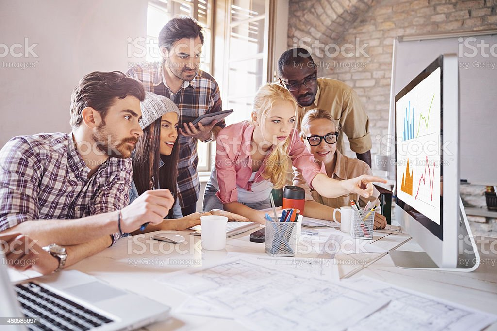 Photo of a designer team working on a project stock photo