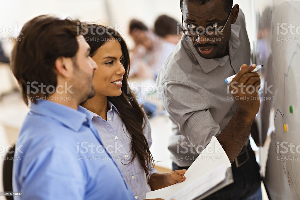 Photo of a designer team working together in office stock photo