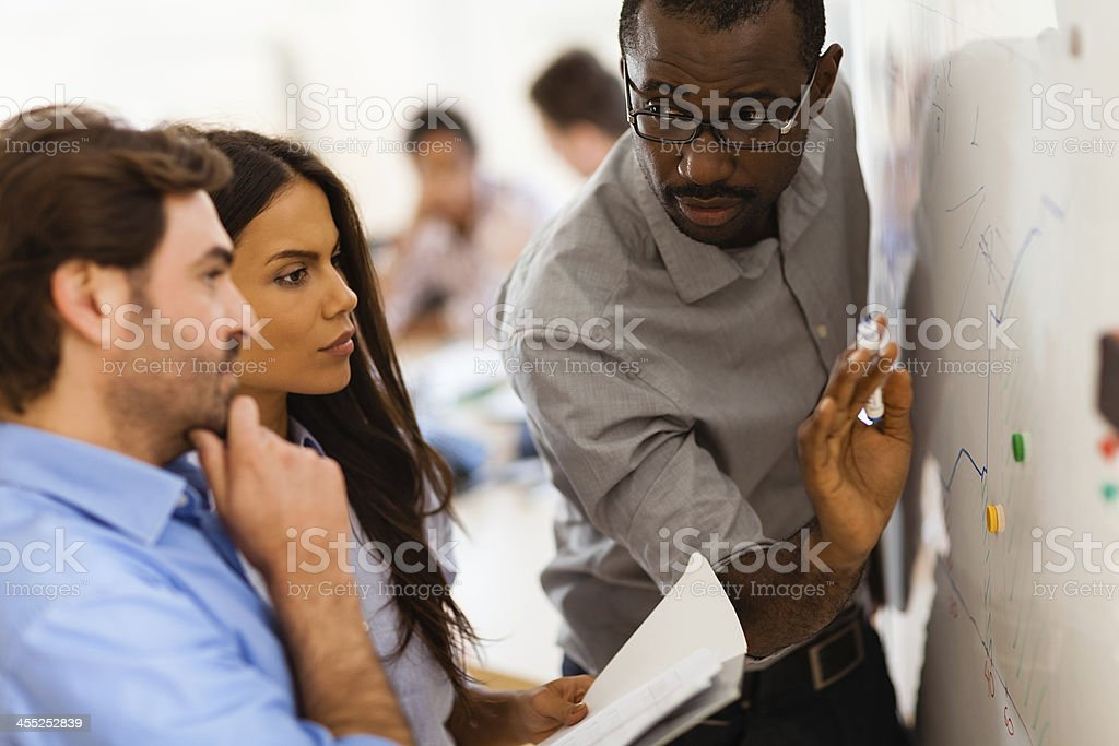Photo of a designer team writing on white board stock photo