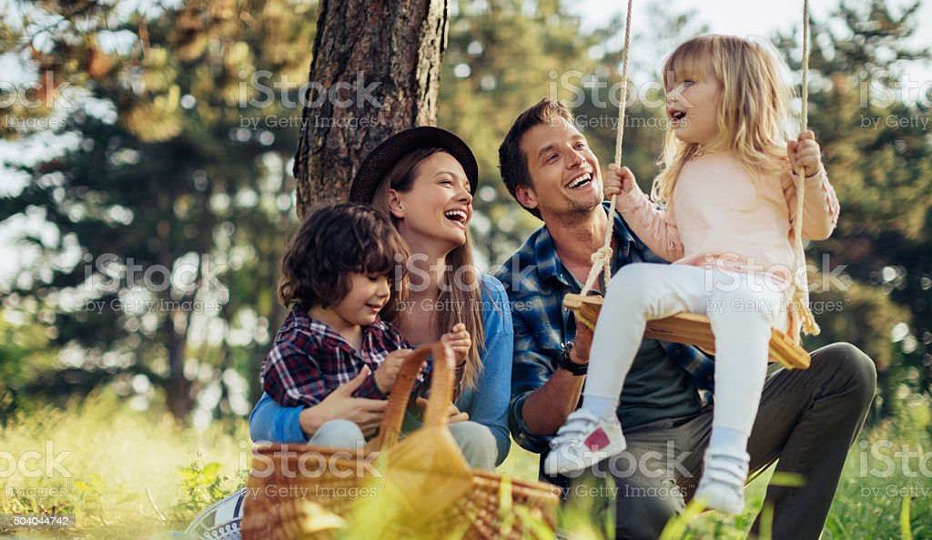 Photo of a family having picnic in the forest stock photo
