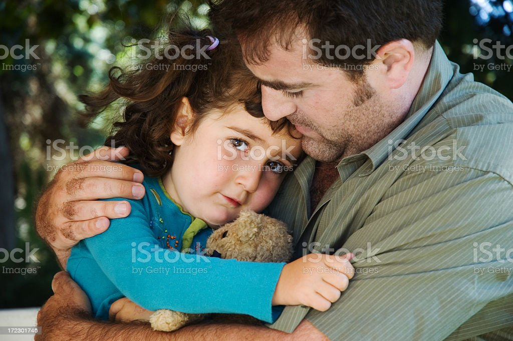 Photo of a father comforting his young daughter royalty-free stock photo