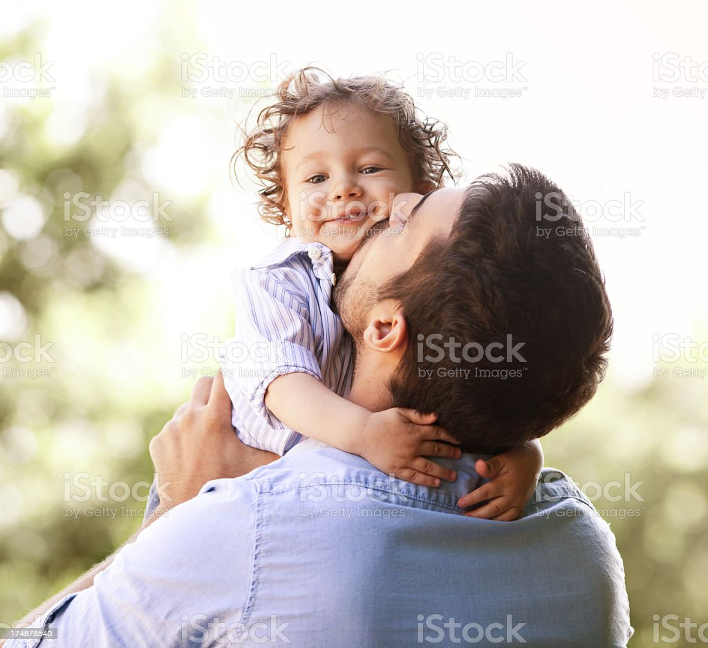Photo of a father holding his son royalty-free stock photo